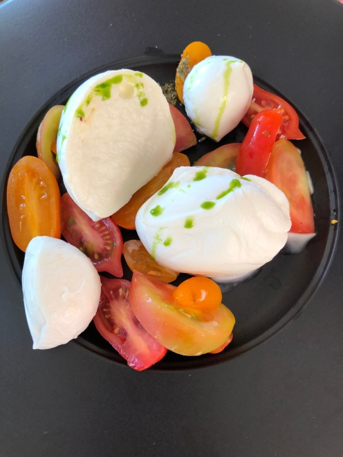 Bufalo mozzarella with trilogy of tomatoes and basil olive oil